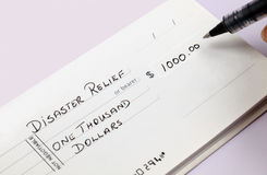 Disaster Relief Check Stock Photo