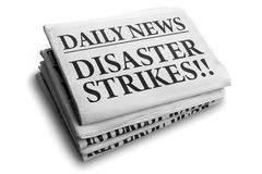 Disaster strikes daily newspaper headline. Daily news newspaper headline reading disaster strikes Stock Photo