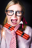 Disaster is a time bomb of explosive stress. Crazy business woman screaming with lit bomb under striped tie while a deadline of explosive stress looms Royalty Free Stock Photos