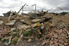 Disaster zone. A disaster zone with pile  of broken concrete slabs, wire,  bricks and rubble from the collapse of a building (caused by earthquake, hurricane or Royalty Free Stock Photos