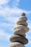 Disbalance stones. Round stones on a background of blue sky stock photography