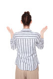 Disbelief - woman looking up with arms raised Royalty Free Stock Photos