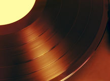 Disc. Rotating brown retro vinyl disc Royalty Free Stock Images