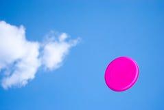 Disc in bleu sky. Purple disc thrown into clear bleu sky Stock Image