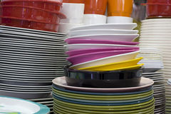 Disc and Bowl. Melamine Disc  and  Melamine Bowl and Melamine Glass are Pile on Table Stock Images