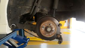 Disc brake on car. In process of new tire replacement Royalty Free Stock Photos