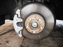 Disc brake on car in process of new tire replacement. The rim is removed showing the rotor and caliper.close up royalty free stock photo