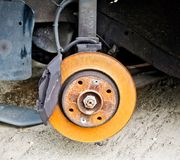 Disc brake filled with car rust. Glass destroyed in thousands of cracks and tears Stock Photos