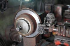 Disc brake fixed by mechanic machine Royalty Free Stock Image