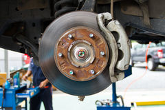 Disc brake. And suspension of lifted automobile at repair service station Royalty Free Stock Image