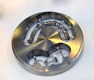Disc CAD CAM dental machinery for milling. Prosthesis and crowns with a cut out bridge for implants close-up Stock Photo