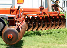 Disc Cultivator. Blades of orange disc cultivator on farm Stock Photos