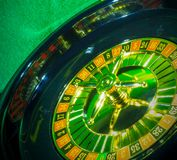 Disc gambling roulette. On a dark background in bright colors stock photo