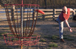 Disc golf. A disc golfer playing the sport of disc golf Royalty Free Stock Photography