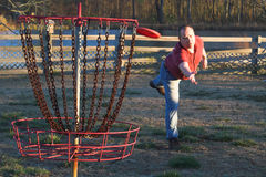 Disc golf. A disc golfer playing the sport of disc golf Royalty Free Stock Photos