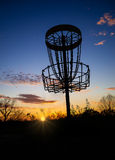 Disc golf basket against sunset Royalty Free Stock Photography