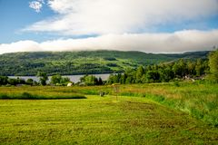 A disc golf basket at the end of the hole with a scenic view to Loch Tay and background hills Royalty Free Stock Images