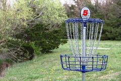 Disc golf basket. Disc golf number 5 basket Stock Photo