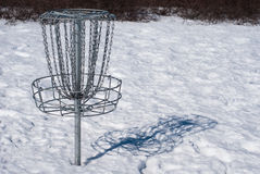 Disc Golf Basket in Snow Stock Photos