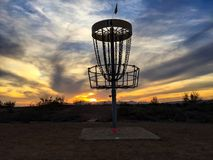 Disc golf course at sunset. A hole along a disc golf course stands tall against a colorful desert sunset near Phoenix Royalty Free Stock Photos