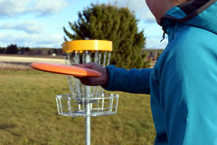 Disc golf course. Teenager aiming disc on frisbee golf course Royalty Free Stock Photography