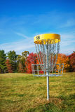 Disc golf hole basket in autumn Royalty Free Stock Photos