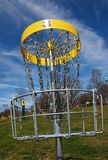 Disc golf hole three basket. The third hole of a disc frisbee golf course stock images
