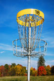 Disc golf target against blue sky Stock Image