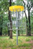 Disc golf target basket in wooded park Royalty Free Stock Photo