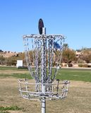 USA: Disc Golf - A Disc Hits The Disc Catcher Royalty Free Stock Image