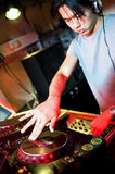 Disc Jockey. At work behind a turn table in a discotheque royalty free stock photography
