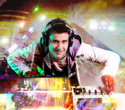 Disc Jockey. Wearning hedphones and mixing records at night club royalty free stock images
