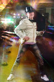 Disc Jockey. Dancing with microphone and headphones at night club royalty free stock photo