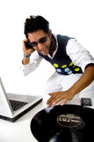 Disc jockey in action Stock Photo