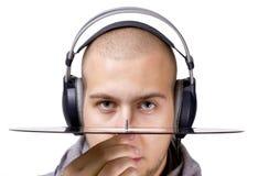 Disc jockey con los auriculares y el vinilo Fotografía de archivo