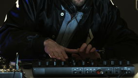 Disc Jockey Dancing and Changing Settings of the Sound Control System. DJ prepares to a party. Close-up. Shot on RED Epic stock video footage
