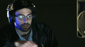 Disc Jockey Dancing and Shaking His Head. DJ prepares to a party. Close-up. Shot on RED Epic stock video