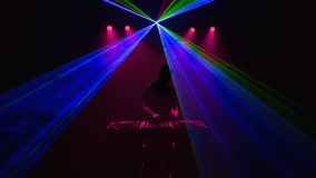 Disc jockey, DJ, Silhouette on laser beams Stock Photo