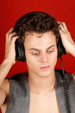 Disc jockey with earphones Royalty Free Stock Photography