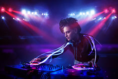 Free Disc Jockey Girl Playing Music With Light Beam Effects On Stage Stock Photo - 79832990