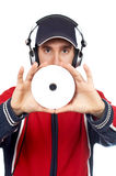 Disc Jockey holding a compact. Disc over a white background. Focus on compact disc stock images