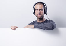 Disc jockey lean on the blank banner Royalty Free Stock Images