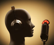 Disc Jockey. Microphone in front of the human head Royalty Free Stock Photos