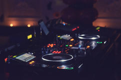 Disc Jockey mixing deck and turntables Stock Photography