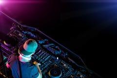 Disc jockey mixing electronic music in club Stock Photos