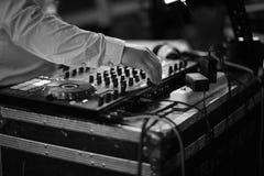 Disc jockey mixing music in the studio Royalty Free Stock Image