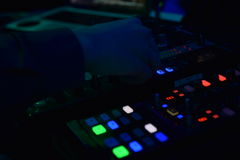 Disc jockey with mixing table take controls royalty free stock photos