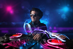 Disc jockey playing music with electro light effects and lights Royalty Free Stock Image