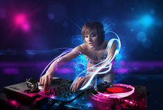 Disc jockey playing music with electro light effects and lights. Beautiful disc jockey playing music with electro light effects and lights royalty free stock photography
