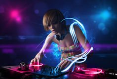 Disc jockey playing music with electro light effects and lights. Beautiful disc jockey playing music with electro light effects and lights Royalty Free Stock Image